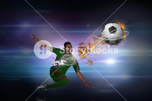Composite image of football player in green kicking
