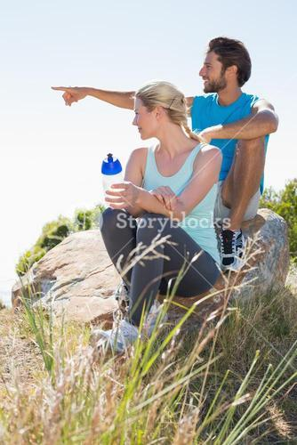 Fit couple taking a break at summit