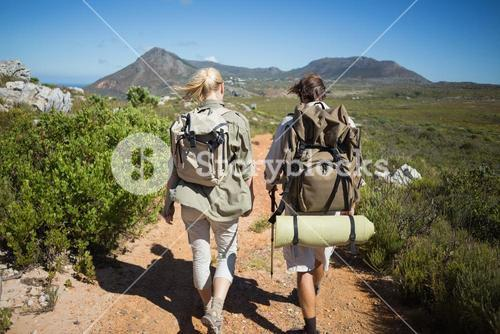 Hiking couple walking on mountain terrain