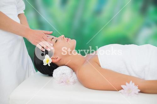 Beautiful brunette enjoying a head massage
