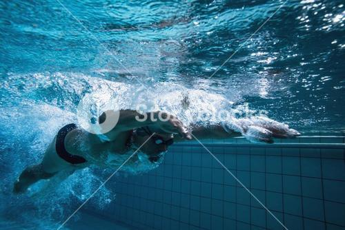 Fit swimmer training by himself