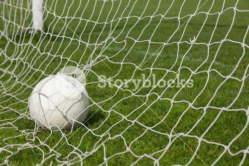 Football at the back of the net