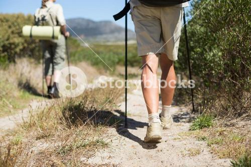 Hiking couple walking on country trail