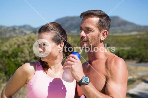 Active couple jogging in the countryside