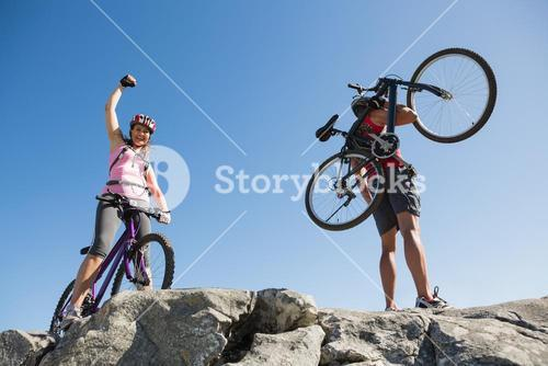Fit cyclist couple at the summit