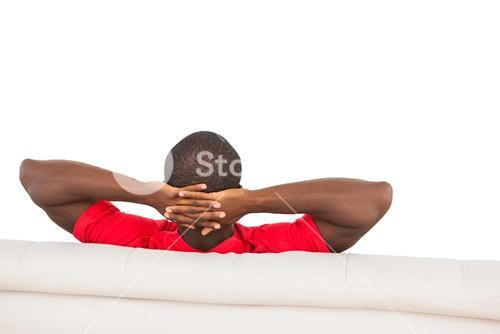 Man in red jersey sitting on couch