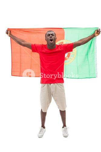 Excited portugal football fan in red cheering