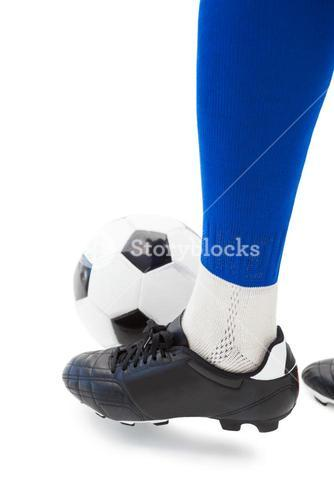 Football players foot with ball