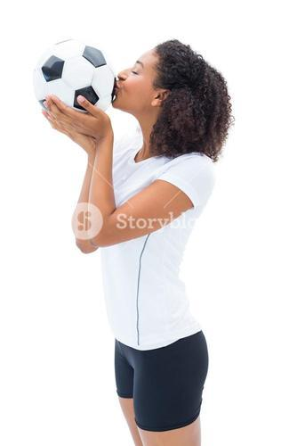 Pretty football fan in white kissing ball