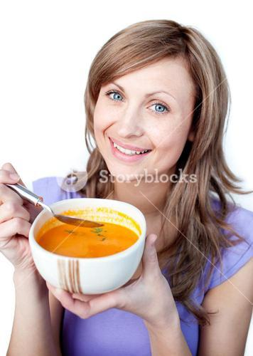 Lively woman holding a soup bowl