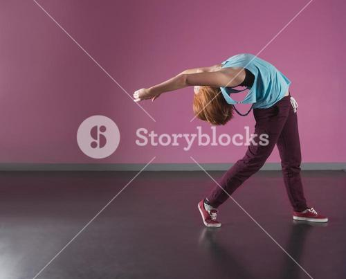 Pretty break dancer bending backwards