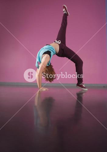 Pretty break dancer bending backwards with leg up