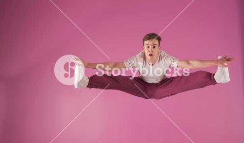 Cool break dancer mid air doing the splits