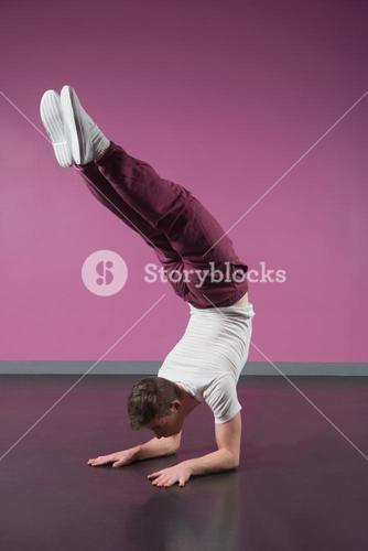 Cool break dancer doing handstand