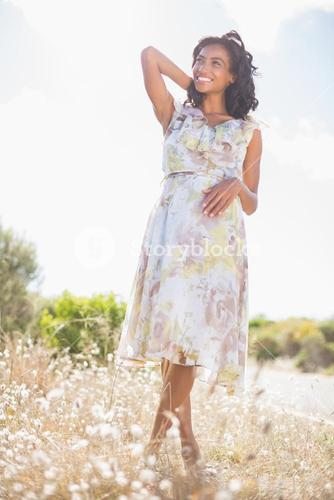 Beautiful woman in floral dress smiling