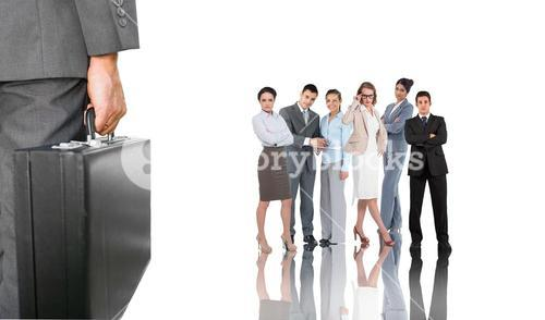 Composite image of businessman holding briefcase