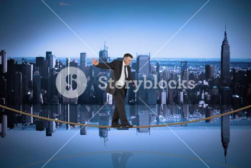 Composite image of mature businessman doing a balancing act on tightrope