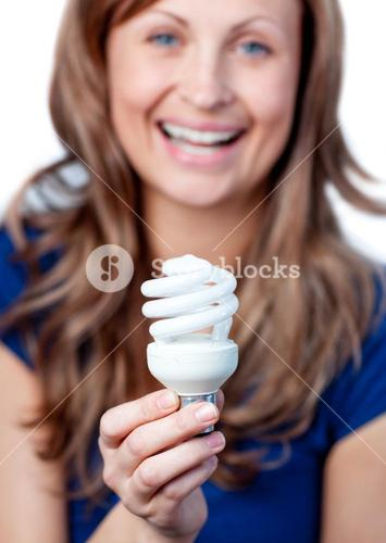 Radiant woman is holding a lightbulb