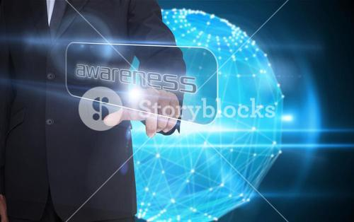 Businessman pointing to word awareness