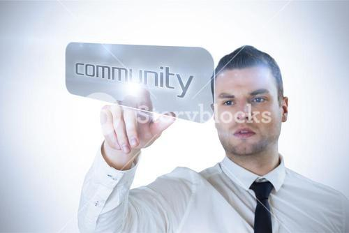 Businessman pointing to word community