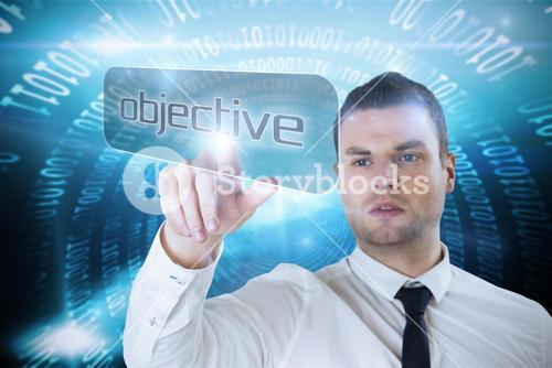 Businessman pointing to word objective