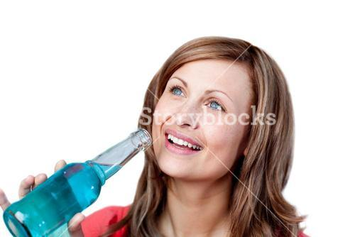Smiling woman drinking a blue beverage