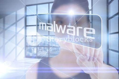 Businesswoman pointing to word malware