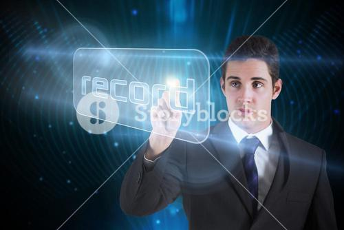 Businessman pointing to word record