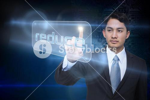Businessman pointing to word reduce