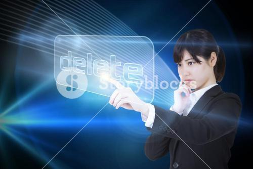 Businesswoman pointing to word delete