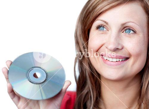 Radiant woman holding a cd rom
