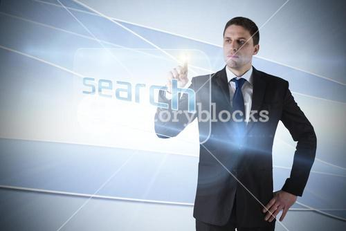 Businessman pointing to word search