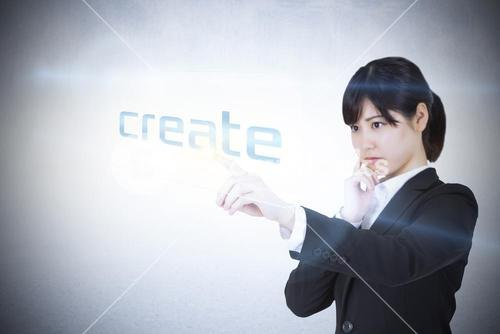 Businesswoman pointing to word create