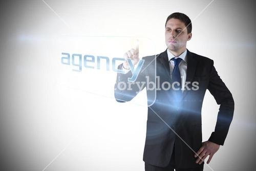 Businessman pointing to word agency