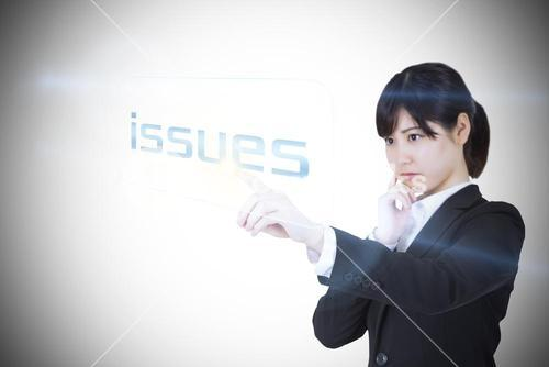 Businesswoman pointing to word issues
