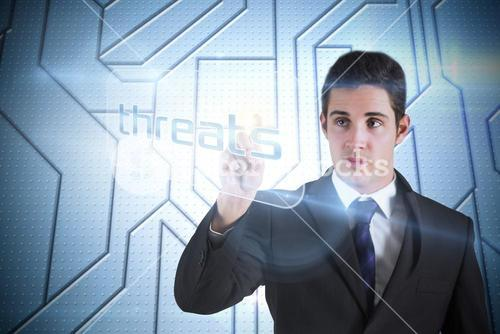 Businessman pointing to word threats