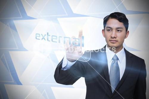 Businessman pointing to word external