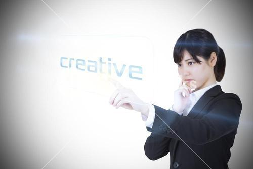 Businesswoman pointing to word creative