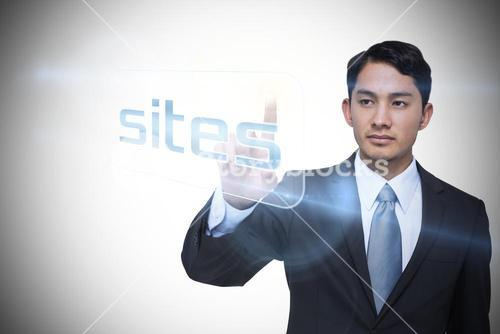 Businessman pointing to word sites