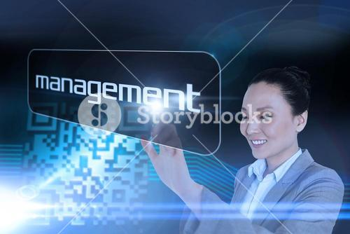 Businesswoman pointing to word management