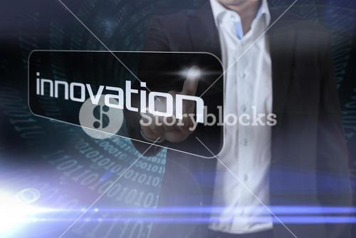 Businessman pointing to word innovation