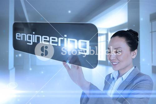 Businesswoman pointing to word engineering