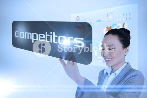 Businesswoman pointing to word competitors