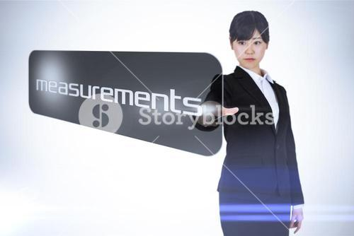 Businesswoman pointing to word measurements