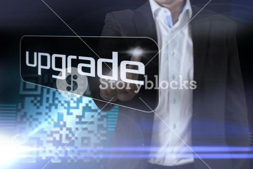 Businessman pointing to word upgrade