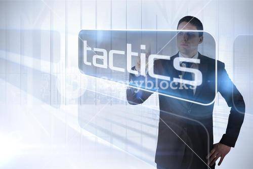 Businessman presenting the word tactics