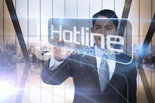 Businessman presenting the word hotline