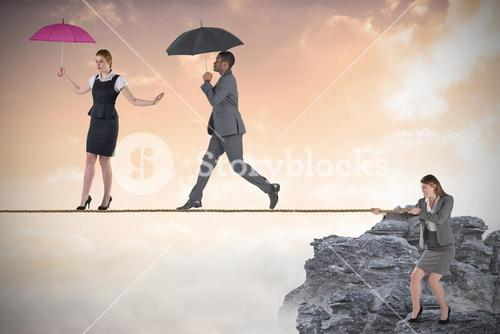 Young business woman pulling a tightrope for business people