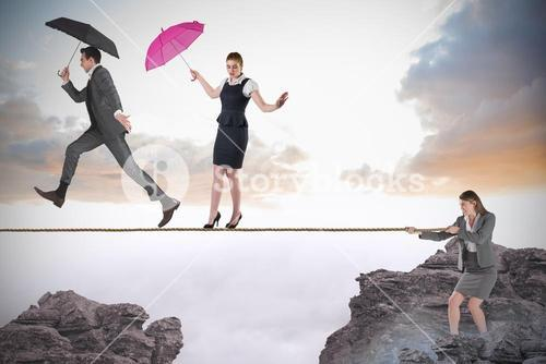 Young businesswoman pulling a tightrope for business people