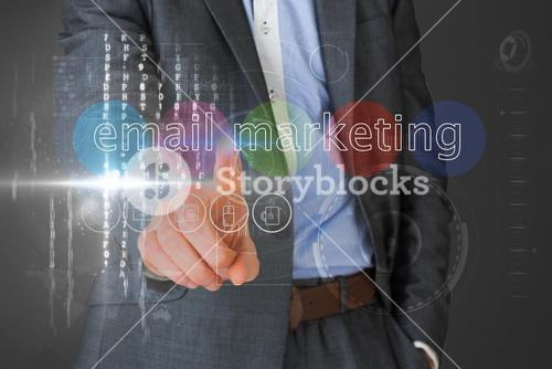 Businessman touching the words email marketing on interface